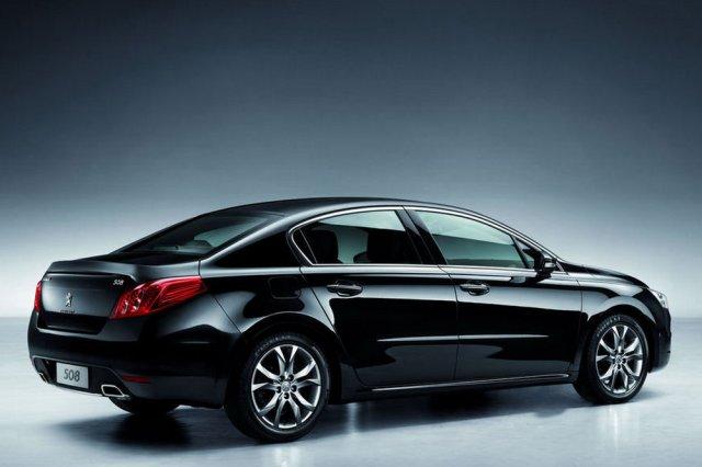 black-peugeot-sedan